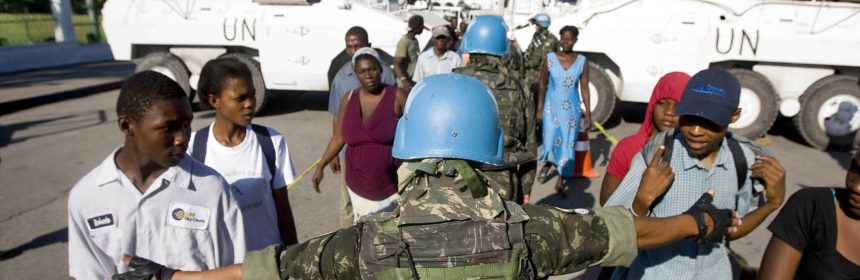 Brazilian UN peacekeepers distribute food and water downtown Port au Prince. Port au Prince Haiti was rocked by a massive earthquake, Tuesday January 12, devastating the city and leaving thousands dead. Photo Marco Dormino